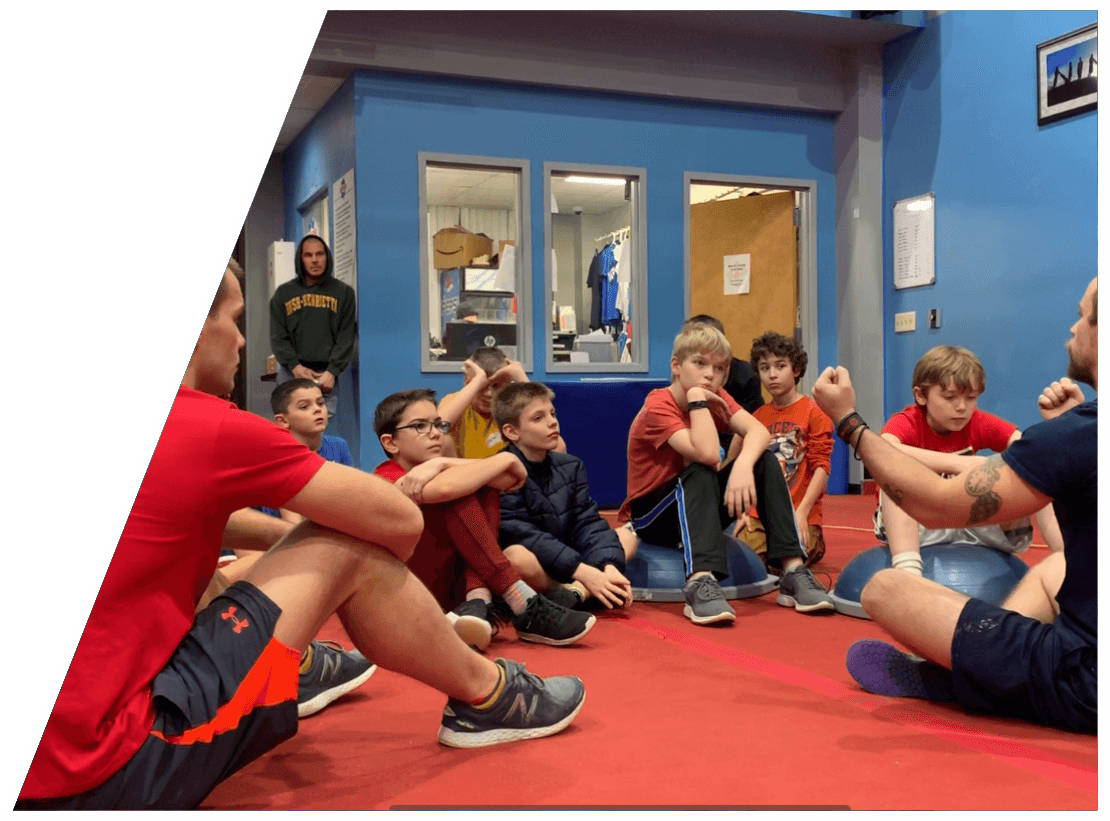A group of kids sitting in a circle at The Warrior Factory Summer Camp